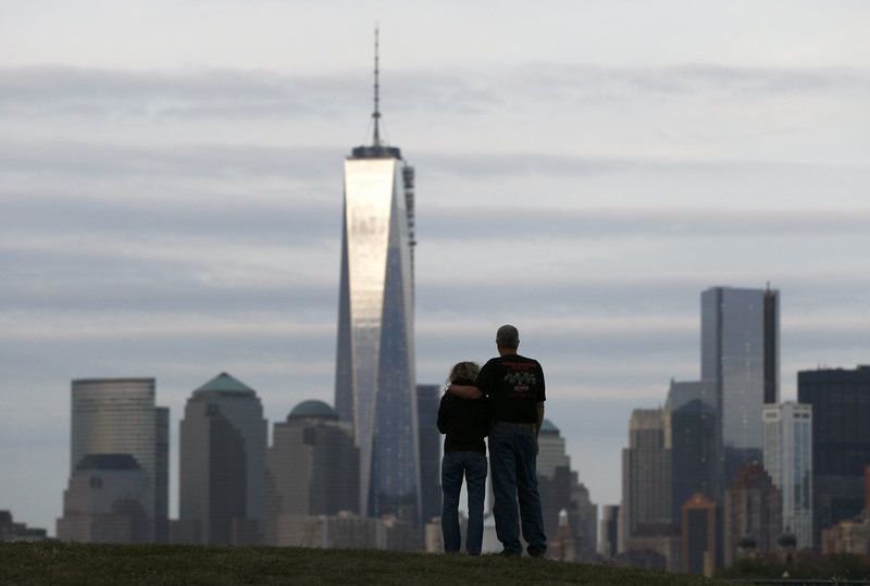 A couple looks at New York's Lower Manhattan and One World Trade Center from Liberty State Park in Jersey City, N.J. on Monday. New York will mark the 12th anniversary of the Sept. 11 attack on the World Trade Center on Wednesday.