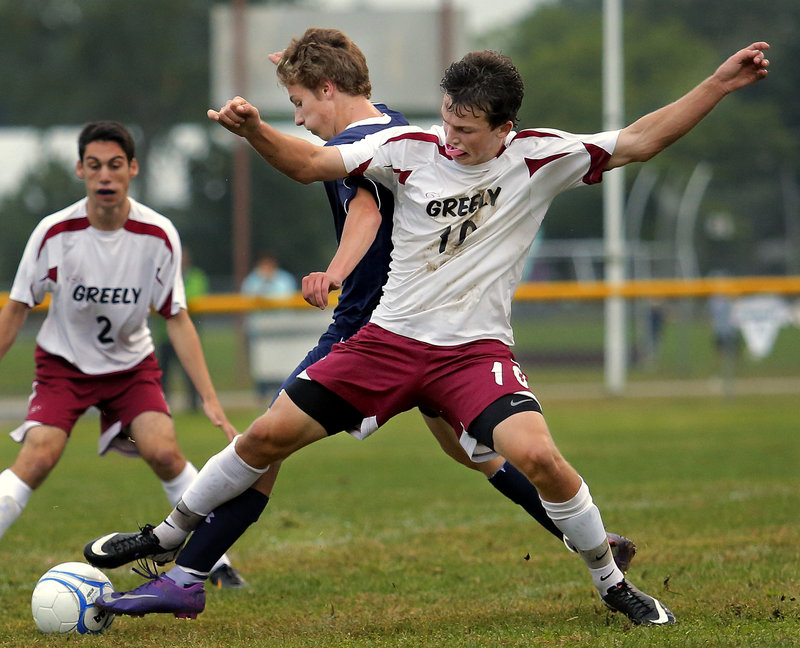 Matt Crowley of Greely stretches to try to keep the ball away from David Clemmer of Yarmouth during their Western Class B boys' soccer game Tuesday night. Yarmouth scored two late goals for a 2-2 tie.