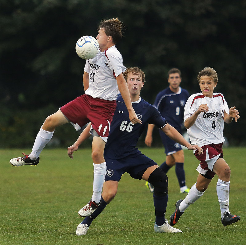 Aidan Black of Greely looks to chest the ball down in front of Wyatt Jackson of Yarmouth during their 2-2 tie at Cumberland in a Western Class B game Tuesday.