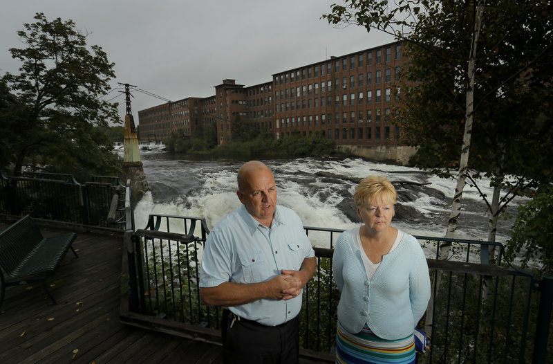 Mayor Colleen Hilton and William Baker, assistant city administrator, talk Tuesday about the economic future of Westbrook, especially the potential removal of the Sappi dam on the Presumpscot River, while standing in Saccarappa Park.