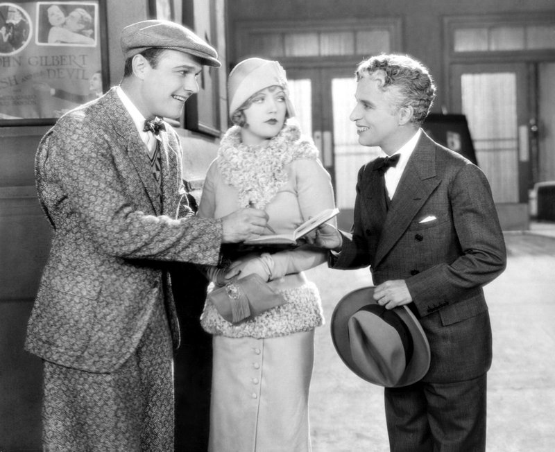 """William Haines and Marion Davies meet an out-of-costume Charlie Chaplin, right, in """"Show People,"""" a classic 1928 silent comedy to be screened with live music on Thursday at 8 p.m. at the Leavitt Theatre in Ogunquit."""