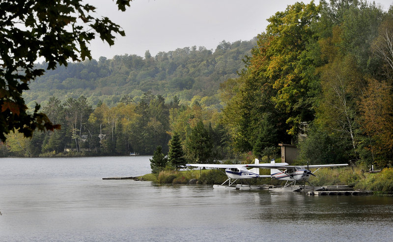 Seaplanes rest on Lower Shin Pond in Mount Chase, where the local economy depends on snowmobiling and hunting.