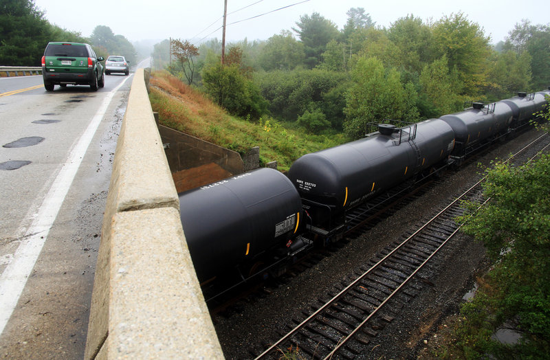 Oil-tank rail cars sit idle and empty near Route 115 in Yarmouth, Maine on July 18, 2013.