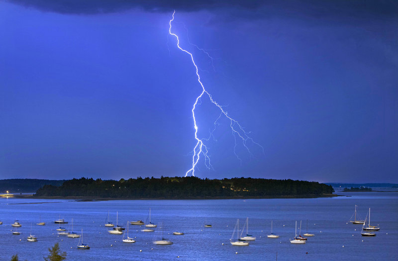 Lightning strikes north of Falmouth's Mackworth Island Wednesday. Weather officials said there were more than 1,000 lightning strikes per hour at the storm's height.