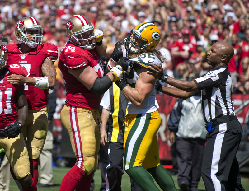Green Bay linebacker Clay Matthews, right, mixes it up with San Francisco's Joe Staley after hitting quarterback Colin Kaepernick late in last Sunday's season opener.