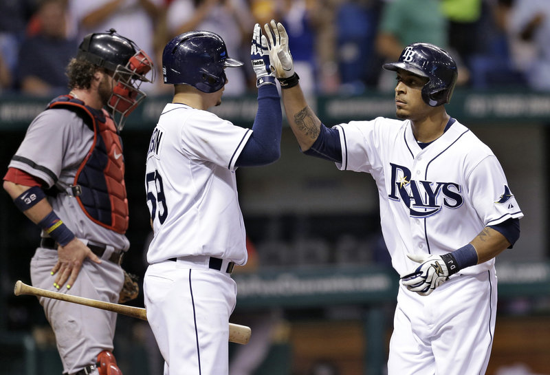 Desmond Jennings, right, receives a welcome-home from Jose Lobaton after hitting a home run in the third inning Thursday night for Tampa Bay in a 4-3 win over Boston. The catcher is Jarrod Saltalamacchia.