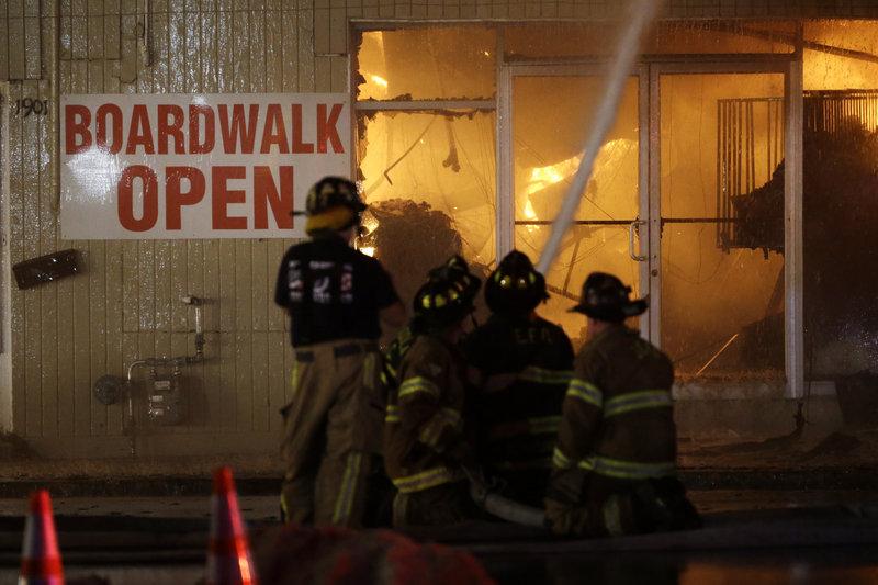 Firefighters battle a blaze on the boardwalk Thursday in Seaside Park, N.J. The fire began in a frozen custard stand on the Seaside Park section of the boardwalk.