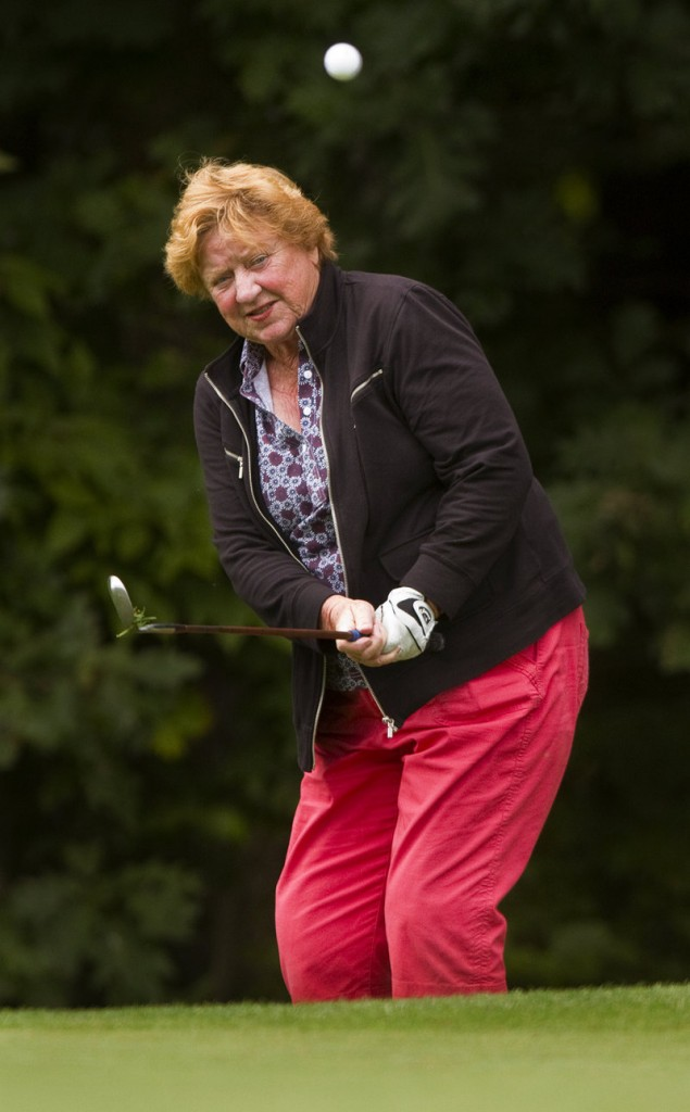 Hall-of-Famer JoAnne Carner, who rackd up 43 victories on the LPGA tour, chips on the ninth green Saturday at Falmouth Country Club. At plus-8, Carner is well back of the contenders.