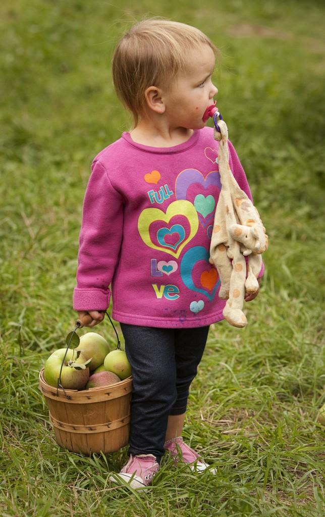 Kami Leroux, 2, of Peaks Island totes her own basket – and a friend.