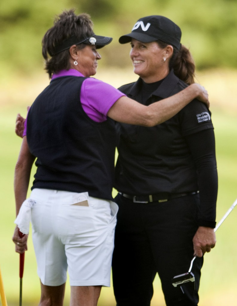 Rosie Jones, left, hugs challenger Lorie Kane after winning a five-hole playoff Sunday to capture the Harris Golf Charity Classic at Falmouth Country Club.