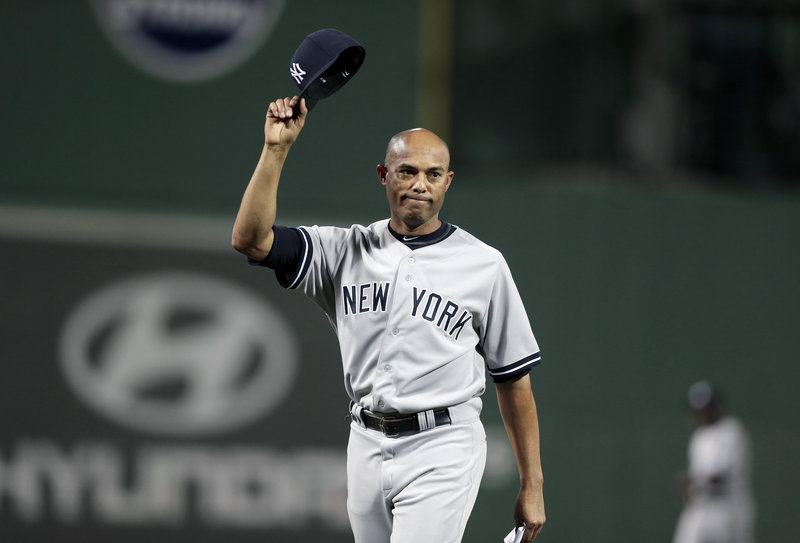 Mariano Rivera, the renowned and soon-to-retire Yankees reliever, acknowledges the crowd as his career was celebrated in a pre-game ceremony Sunday at Fenway Park.