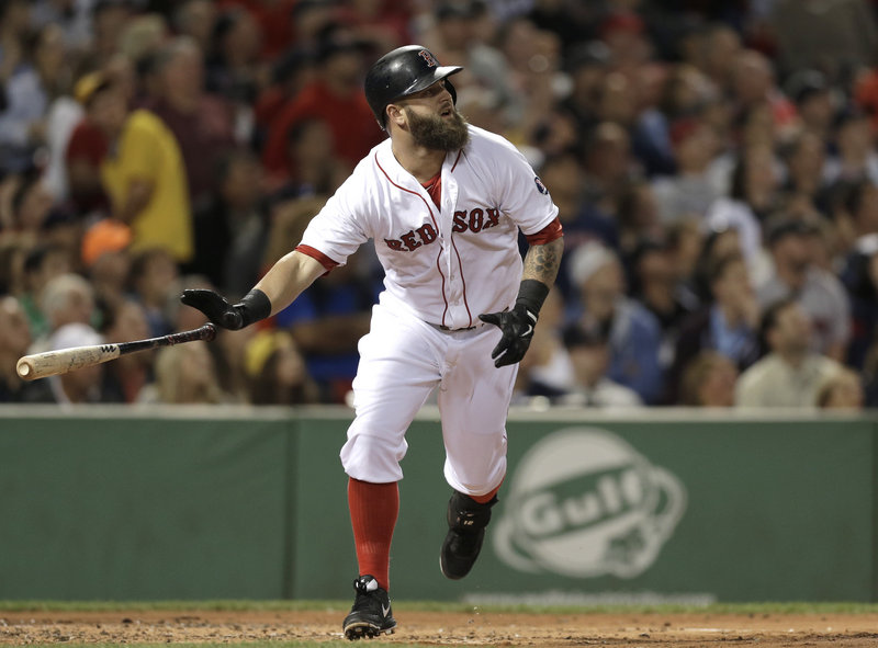 Boston's Mike Napoli watches his first inning, two-run homer sail toward the center field stands during a 9-2 win over the New York Yankees on Sunday night.
