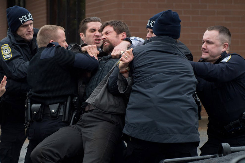 Jake Gyllenhaal as Detective Loki tries to get a grip on an enraged Keller Dover, played by Hugh Jackman.