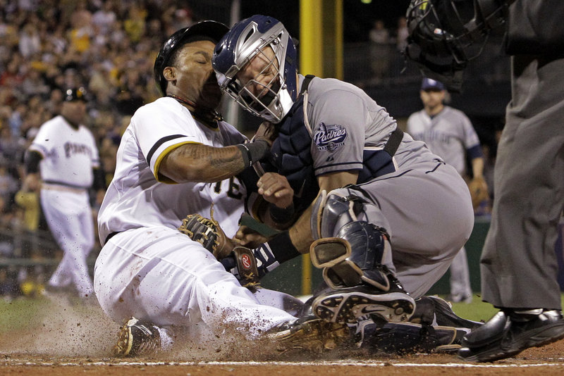 Pittsburgh's Marlon Byrd is tagged out by San Diego catcher Nick Hundley in the third inning of the Pirates' 5-2 loss at Pittsburgh on Tuesday night.