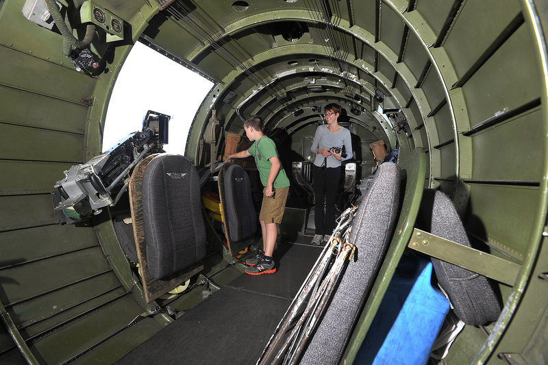 Nathan Giddinge, 10, of Pownal, checks out the interior of the B-17 bomber with his mother, Erica. She said her son recently brought home a library book about World War II aircraft and has been talking to his grandfather about the war.