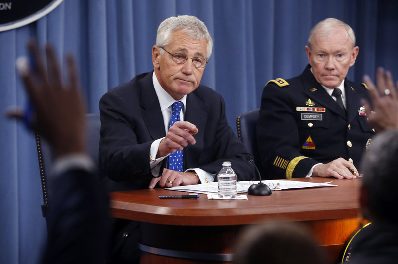 Defense Secretary Chuck Hagel and Chairman of the Joint Chiefs of Staff Gen. Martin Dempsey take questions at The Pentagon Wednesday after Hagel said he is ordering a review of the physical security of all U.S. defense facilities worldwide.