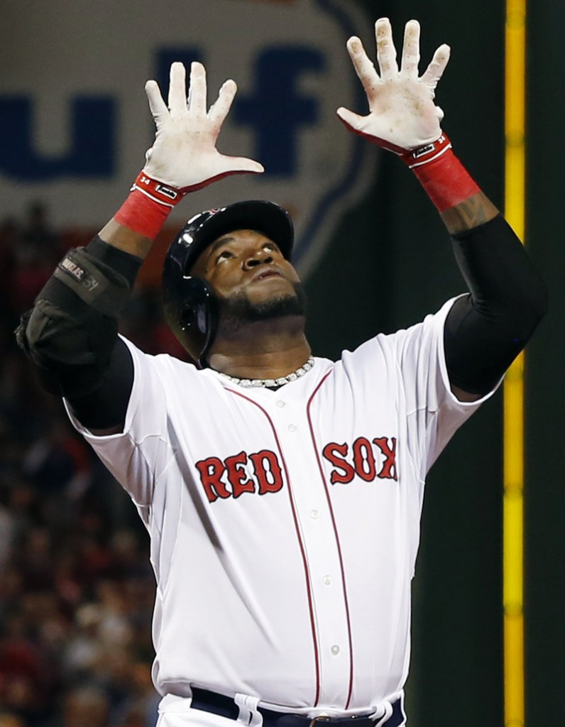 Boston's David Ortiz raises his hands as he crosses the plate after hitting a two-run homer in the first inning of what turned out to be a 5-3, 12-inning loss to the Orioles at Fenway Park.