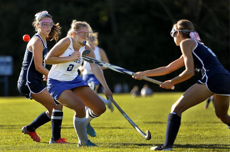 York's Sarah Panteleos fires the ball past Kennebunk's Meg Cadigan during the Wildcats' 5-0 win Thursday.