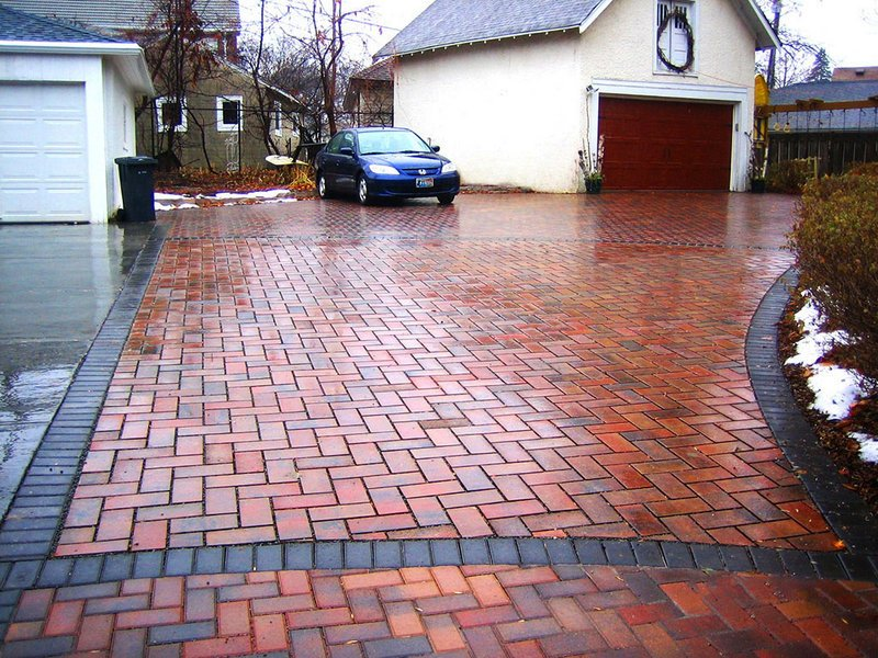 Permeable pavers in a Minnesota driveway let water absorb back into the ground rather than running off and carrying pollution to the nearest water.