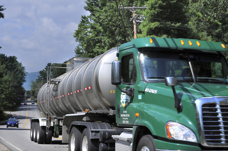 A full Nestle/Poland Spring water truck heads south on Route 113 in Fryeburg. The Fryeburg Water Co. is seeking Maine Public Utilities Commission approval of a contract to sell water to Nestle. All three commissioners and the state's public advocate have ties to Nestle.