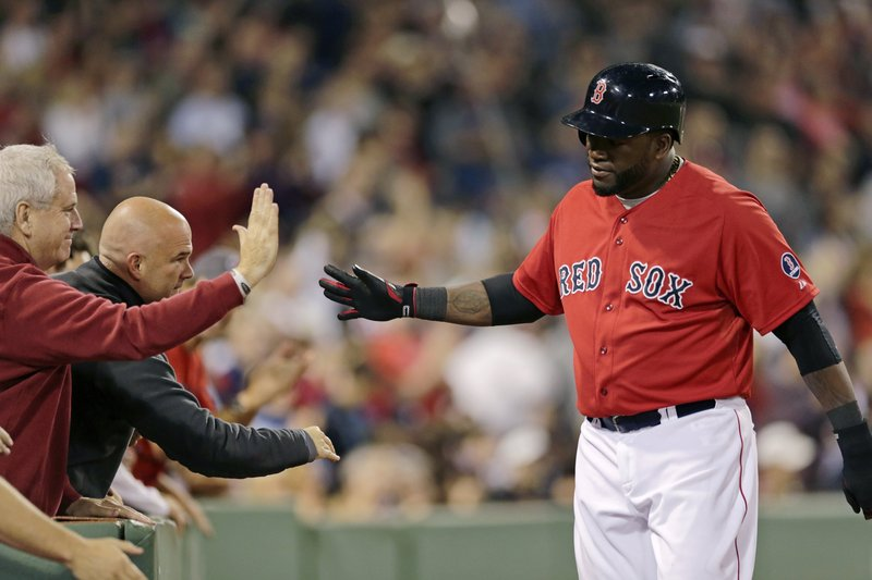 That's right, David Ortiz shares the moment with fans after scoring a run in the seventh inning of Friday night's 6-3 win over the Blue Jays.