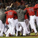 It was not your typical celebration after the Red Sox secured a 6-3 win over Toronto on Friday night. Tampa Bay was eliminated from playoff contention and the Red Sox rushed the mound the revel in their AL East-clinching win.