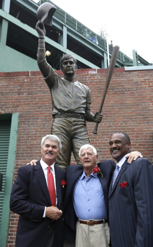 Accompanied by former teammates Dwight Evans, left, and Jim Rice, right, Carl Yastrzemski stands by the new statue outside Fenway Park.