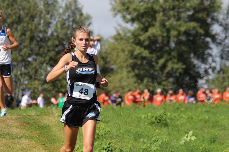 Brittney Sorbello, a high school field hockey standout, is focusing on cross country at UNE, winning two big meets.