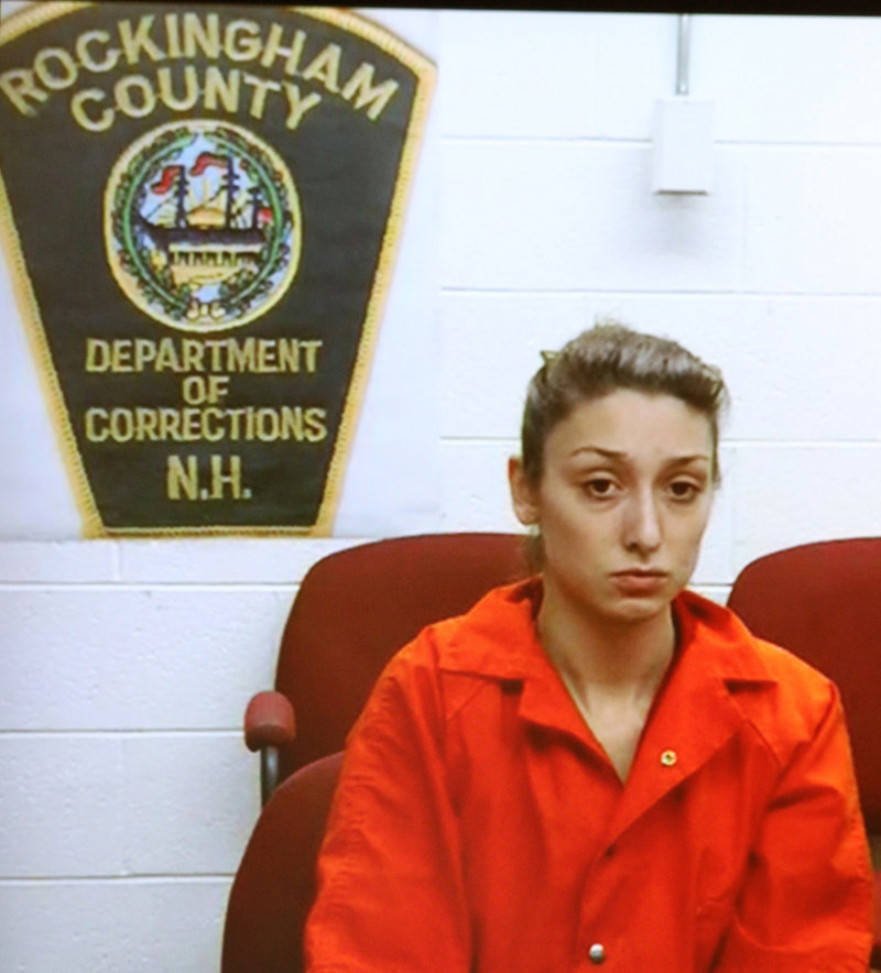 Darriean Hess, 19, of Seabrook, N.H., left, is arraigned via video in Seabrook, N.H. Wednesday, Sept. 25, 2013. Hess is charged with two counts of negligent homicide and two counts of assault after she plowed into a group of cyclists on Saturday on a bridge during an annual ride in Hampton. Two riders died and two were injured.
