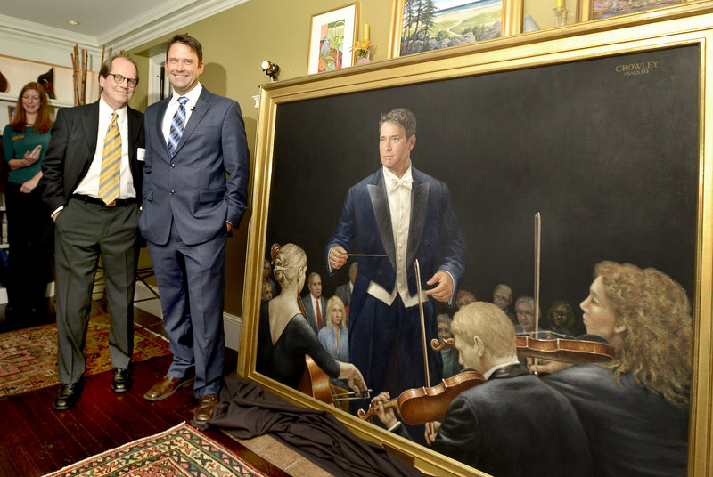 Artist James Crowley and Portland Symphony conductor Robert Moody stand next to a 54