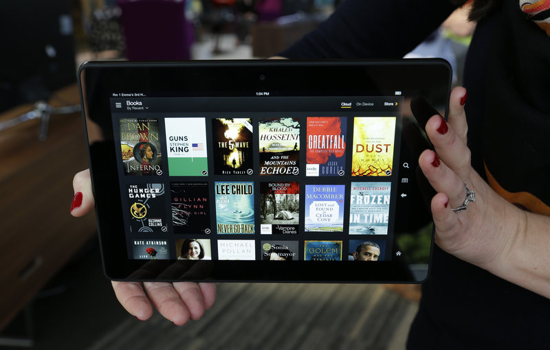 An 8.9-inch version of the Amazon Kindle Fire HDX tablet device is shown Tuesday in Seattle. The company described its latest HDX series as three times faster than the older Kindle Fire line.
