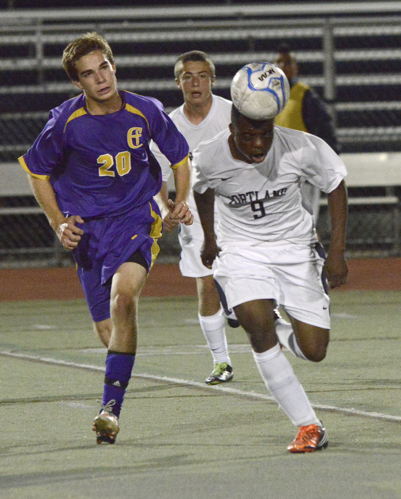 Yusef Yama of Portland heads the ball up the field Thursday while being chased by Alex Nason of Cheverus during their SMAA game at Fitzpatrick Stadium. Yama scored the tying goal after Nason opened the scoring in a 1-1 game.