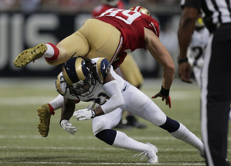 Tight end Vance McDonald of the San Francisco 49ers is upended by cornerback Janoris Jenkins of the St. Louis Rams after making a catch Thursday night in the second quarter of the 49ers' 35-11 victory.