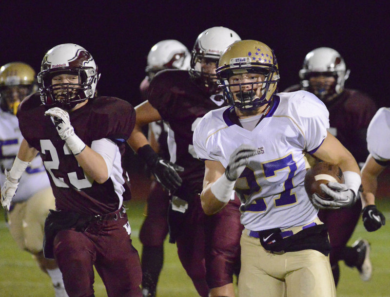 It was a familiar sight Friday night, Joe Fitzpatrick running with the ball for Cheverus and the Windham defense in pursuit. Fitzpatrick totaled 243 yards on 25 carries as the Stags pulled away to a 57-22 victory in a game between undefeated Eastern Class A teams.