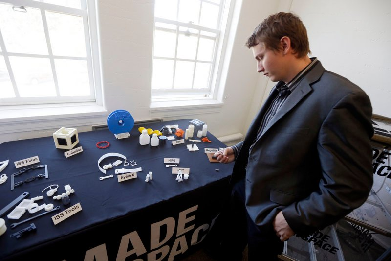 Aaron Kemmer, CEO and co-founder of Made In Space, in Mountain View, Calif., on Sept. 16, looks at items useful in outer space that were made with the company's 3-D printer.