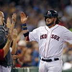 Boston's Jarrod Saltalamacchia , right, receives high-fives after scoring the winning run on Aug. 28 in a game against the Baltimore Orioles at Fenway Park. With catcher Jason Varitek now in his second year of retirement, Saltalamacchia is the new leader.