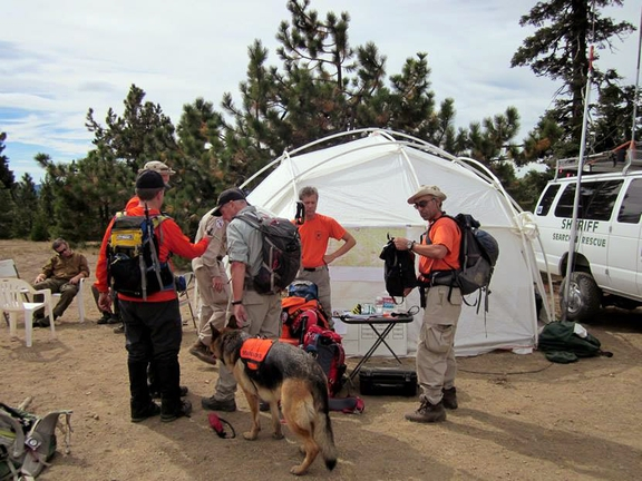 Volunteers and rescue workers gather before searching for missing hunter Gene Penaflor, who got hurt in a Northern California forest and was rescued Saturday after being lost for 19 days.