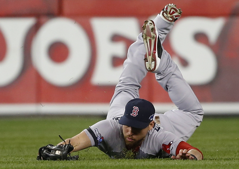 Jacoby Ellsbury of the Boston Red Sox makes a diving catch on a ball hit by Omar Infante of the Detroit Tigers in the second inning.