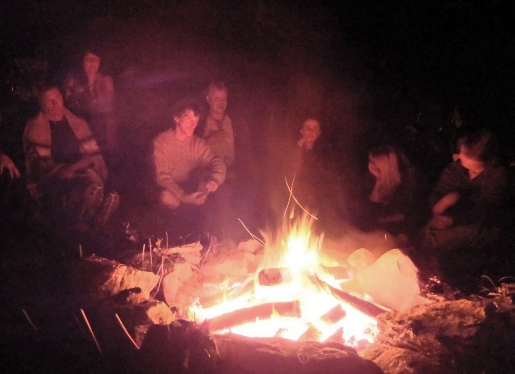 The fire glows at a gathering of druids.