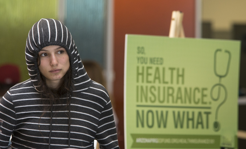 Phoenix College freshman Willow Kanowshy listens to an Affordable Care Act information session at the college's student union in Phoenix. Many consumers have been frustrated after efforts by the federal government and states running their own health insurance exchanges saw a rollout marred by overloaded websites and jammed phone lines.