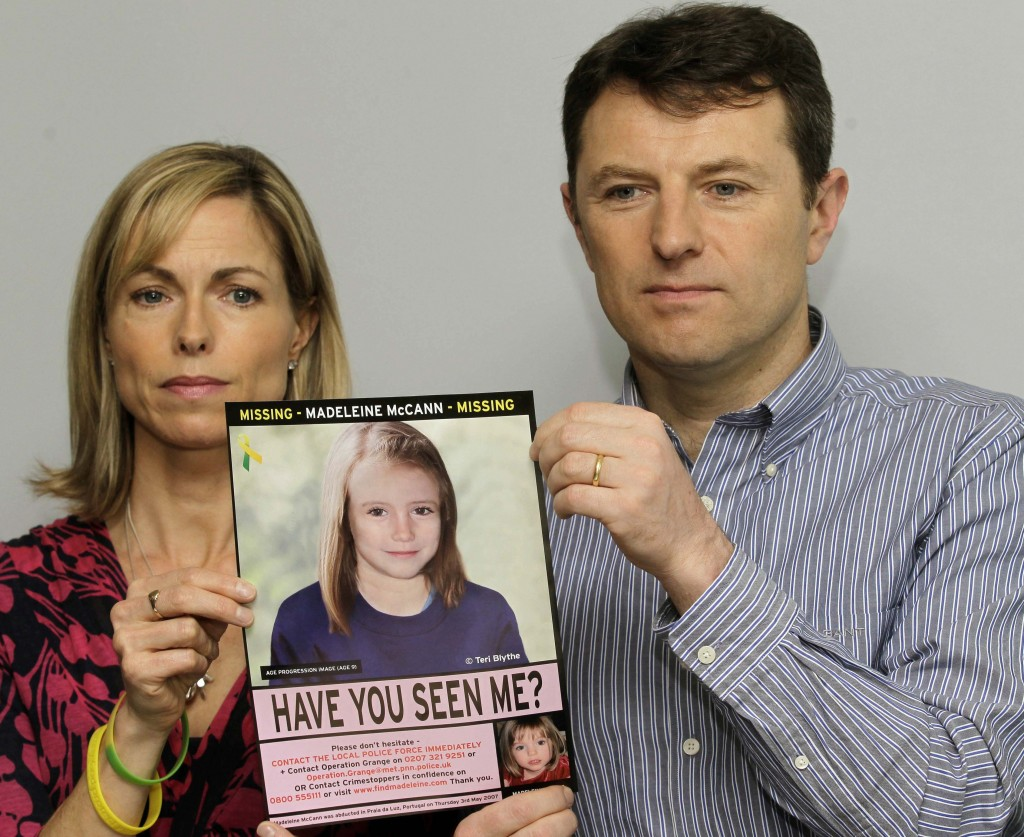 Kate and Gerry McCann hold a poster depicting an age progression of how their daughter Madeleine, who went missing in Portugal in 2007, might now look.