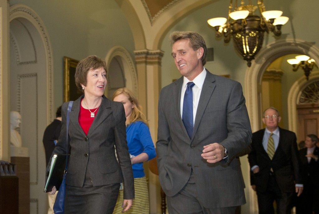 Sen. Jeff Flake, R-Ariz., right, and Sen. Susan Collins, R-Maine., walk together on Capitol Hill on Wednesday in Washington. Leaders reached a last-minute agreement to avert a threatened Treasury default and reopen the government after a partial, 16-day shutdown.