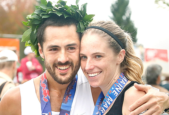 Rob Gomez of Saco receives a hug from his girlfriend, Breagh MacAulay, after winning the Maine Marathon Sunday in a time of 2:24:21 in Portland on Sunday.