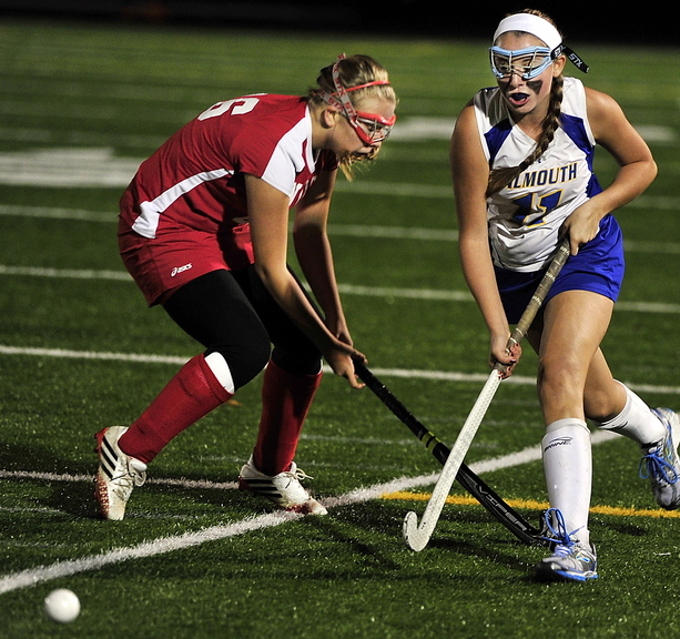 Kate Lannon of Falmouth moves in against Marissa Nance of Sanford during Falmouth's 4-0 victory Wednesday night in a Western Class A field hockey quarterfinal.