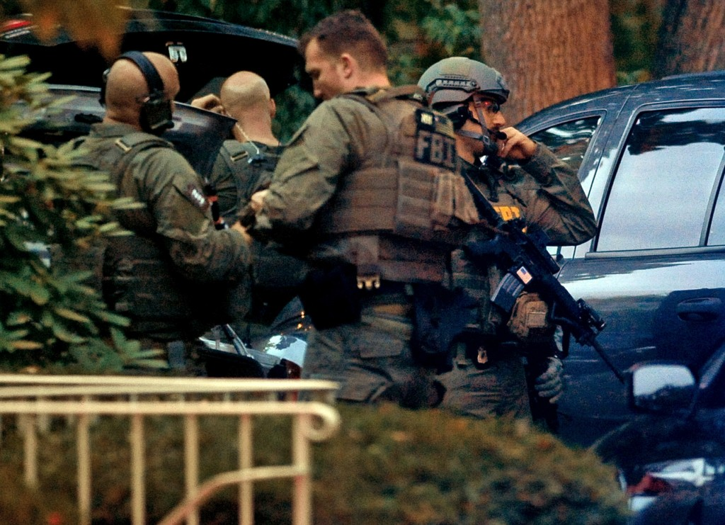 Members of the FBI suit up outside the residence of Miriam Carey in Stamford, Conn. Thursday, Oct. 3, 2013. Law-enforcement authorities have identified Carey, 34, as the woman who, with a 1-year-old child in her car, led Secret Service and police on a harrowing chase in Washington from the White House past the Capitol Thursday, attempting to penetrate the security barriers at both national landmarks before she was shot to death, police said. The child survived.