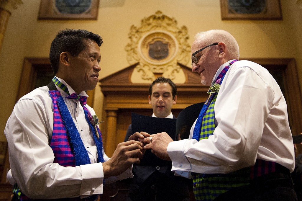 David Gibson, right, and Richard Kiamco of Jersey City make history as they become the first official same-sex couple to be married in Jersey City in a ceremony officiated by Mayor Steve Fulop at 12:01 a.m. Monday. Seven other gay couples also participated in the ceremony.