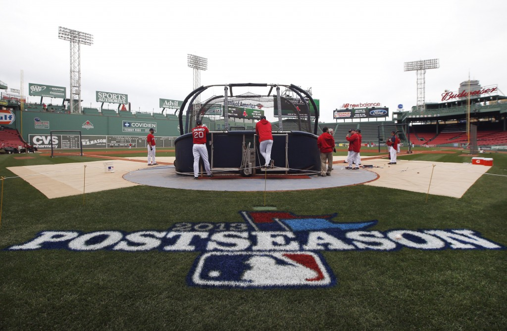 Boston Red Sox baseball players gather around the batting cage during a workout at Fenway Park in Boston on Thursday in preparation for Game 1 of the AL championship series against Detroit on Saturday.