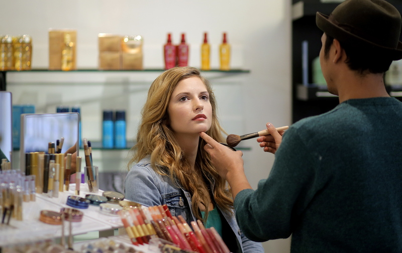 Beauty-pageant contestant Tara Cavanagh of Portland works with editorial stylist Peter-John Ulloa at Akari Salon on Tuesday. Cavanaugh is using crowd-funding to pay for her Miss Maine campaign.