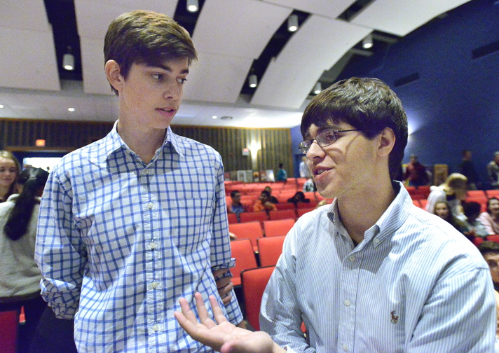 Government students Tim Hartel and Brian Nestor, both seniors, share their thoughts after the Maine Supreme Judicial Court heard oral arguments of several cases at Cape Elizabeth High School.