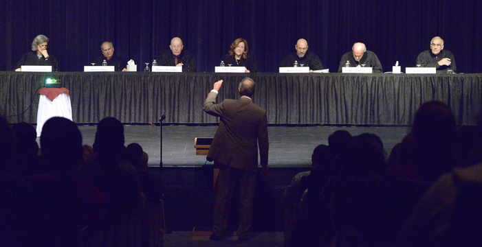 Attorney Sheldon Tepler addresses the Maine Supreme Judicial Court as it hears oral arguments at Cape Elizabeth High School. Members are, from left, Justices Ellen Gorman, Warren Silver and Donald Alexander, Chief Justice Leigh Saufley, and Justices Jon Levy, Andrew Mead and Joseph Jabar.
